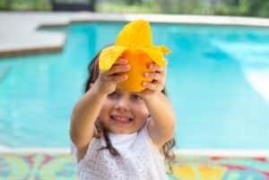 Little Girl Holding Peeled Mango