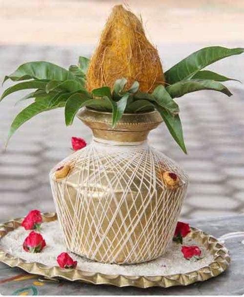Purna Kumbha with mango leaves