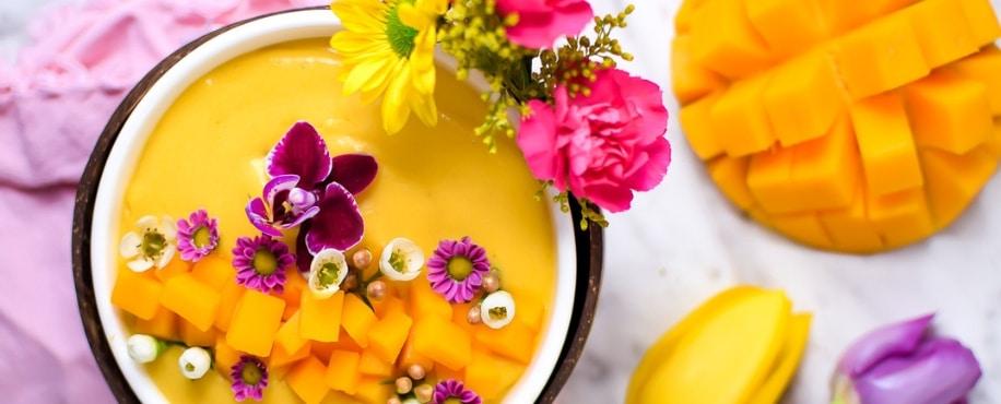 Springtime Mango Smoothie Bowl with Edible Flowers Header